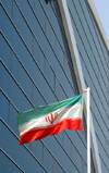 Iran -  Bandar Abbas: Iranian flag and Setareh e Jonub Business and Recreational Center - photo by M.Torres