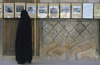 Iran - Isfahan: woman at a photo exhibition - photo by W.Allgower