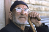 Iran: man with thick glasses - photo by W.Allgower
