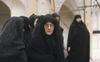 Iran: women wearing black chadors - photo by W.Allgower