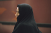 Iran: woman wearing a black chador - photo by W.Allgower
