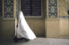 Iran: woman in a white chador - a sign of mourning - photo by W.Allgower