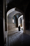Isfahan, Iran: woman and child walk along a vaulted passage - photo by G.Koelman