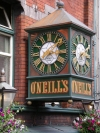 Ireland - Dublin: O'Neils pub - clock detail (photo by R.Wallace)