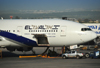 Tel Aviv Ben Gurion Airport, Central District, Israel: El Al Israel Airlines Boeing 777-258(ER), registration 4X-ECF (cn 36084) - aircraft with cargo door open at Terminal 3 - Mitsubishi pick-up - photo by M.Torres