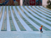 Israel - Shfaim: water park - child alone by the water chutes - blue lines - photo by E.Keren