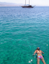 Eilat, South district, Israel: girl snorkeling and tour boat - Gulf of Aqaba - Gulf of Eilat - Mifratz Eilat - photo by E.Keren