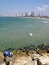 Tel Aviv, Israel: an angler in Yafo looks at the city and the Mediterranean sea - photo by E.Keren