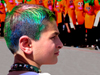 Israel: boy with multi-colored hair and Purim cortege - photo by E.Keren