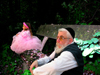 Israel: the ages - conceptual view of old Jew and smal girl in pink dress sitting on a old wooden bench - photo by E.Keren