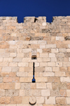 Jerusalem, Israel: west side of the city walls - arrowslit - Six-Day War bullets left pockmarks in the wall - photo by M.Torres