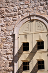 Jerusalem, Israel: Holy Sepulcher church - metal covered window with four small openings - parvis - Christian quarter - photo by M.Torres
