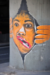 Tel Aviv, Israel:  face with twisted mouth - graffiti on Eliezer Peri Street, below Colosseum Nightclub - photo by M.Torres