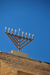Jerusalem, Israel: Menorah atop the Yeshivat Hakotel - Jewish quarter - Blue sky background and copy space for your text - photo by M.Torres