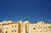 Jerusalem, Israel: stone buildings - view from the Western Wall plaza, Yeshivat Netiv Aryeh - Zionist Orthodox yeshiva - flags and antennas - Jewish quarter - Blue sky background as copy space for your text - photo by M.Torres