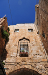 Jerusalem, Israel: stone arch and window over El Wad Ha Gai street - Muslim Quarter - photo by M.Torres