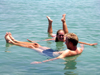 Israel - Dead sea: couple floating - buoyancy caused by high salinity - photo by R.Wallace