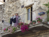 Italy / Italia - Eggi: putting the laundry to dry - balcony with flowers (photo by Emanuele Luca)