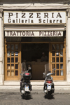 Rome, Italy: mopeds parked outside pizzeria - Galleria Sciarra - photo by I.Middleton