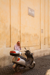 Rome, Italy: Local man on mobile phone in Piazza San Silvestro - photo by I.Middleton