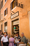 Rome, Italy: people sitting outside a cafe - photo by I.Middleton