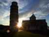 Pisa - Duomo and Pisa tower - silhouetted against the sun - photo by M.Bergsma