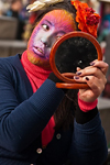 Carnival participant, Iast minute adjustments to make-up, Venice - photo by A.Beaton