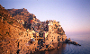 Italy / Italia - Manarola - Cinque Terre -  comune of Riomaggiore, province of La Spezia, Liguria: the town and the sea - UNESCO World Heritage Site - National Park of the Cinque Terre - photo by W.Allgöwer