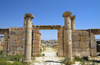 Jerash - Jordan: gate - view of the modern city - Roman city of Gerasa - photo by M.Torres