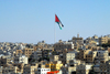 Amman - Jordan: Jordanian flag over the city - photo by M.Torres