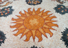 Madaba - Jordan: modern mosaic with the sun - photo by M.Torres