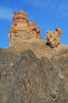 Kazakhstan, Charyn Canyon: Valley of the Castles - harder, darker volcanic rock at the bottom and eroded red sedimentary rocks at the top - photo by M.Torres