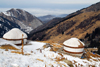 Kazakhstan - Chimbulak ski-resort, Almaty: yurts and the Alatau Mountains - photo by M.Torres
