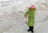 Kazakhstan - Chimbulak ski-resort, Almaty: woman using a rope to walk on the ice - photo by M.Torres