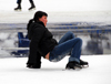 Kazakhstan, Medeu ice stadium, Almaty: a girl recovers from a fall - photo by M.Torres