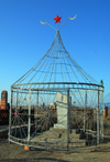 Kazakhstan, Shelek, Almaty province: Muslim cemetery - caged tomb with Islamic crescents and Soviet star - photo by M.Torres