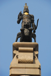 Kazakhstan, Almaty: Republic square - Independence Monument - Golden Warrior on a snow leopard's back - photo by M.Torres