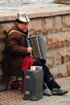 Kazakhstan, Almaty: Arbat - Zhybek-Zholy, or Silk road street - accordion player - street musician with Kazakh hat - photo by M.Torres