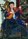 Kazakhstan, Almaty: playing a traditional dombra, a long-necked, stringed instrument - photo by M.Torres