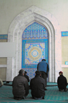 Kazakhstan, Almaty: Central Mosque - men praying - photo by M.Torres