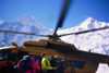 Kazakhstan - Tian Shan mountain range: mountaineers board a russian Mil Mi-8 Hip helicopter to leave from the Khan-Tengri base camp - photo by E.Petitalot