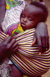 Kenya - Majengo, Mombasa Island, Coast Province: baby sleeping in mother's arms - photo by F.Rigaud