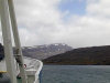 Kerguelen island - TAAF: November - patches of snow remain at the higher elevations - view from the Akademik Shokalskiy (photo by Francis Lynch)