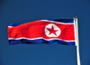 Pyongyang, North Korea / DPRK: the flag of the Democratic People's Republic of Korea flies in a deep blue sky - photo by M.Torres