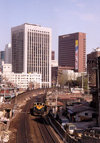 Asia - South Korea - Seoul: railways - train and skyscrapers - photo by M.Torres