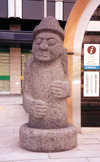 Asia - South Korea - Seoul: sad face -  -  Stone Grandfather  fertility statue - Tol-Harubang from Jeju island / Cheju island - photo by M.Torres