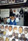 Asia - South Korea - attendant at mask shop - photo by S.Lapides