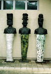 Asia - South Korea - three figures - modern sculptures on the street - photo by S.Lapides
