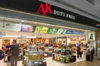 Seoul, South Korea: airport terminal duty free store front of AK with clients and various products including spirits - Incheon International Airport - photo by C.Lovell