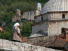 Kosovo - Prizren / Prizreni: woman on the bridge and dome of the Sinan Pasha mosque - photo by J.Kaman